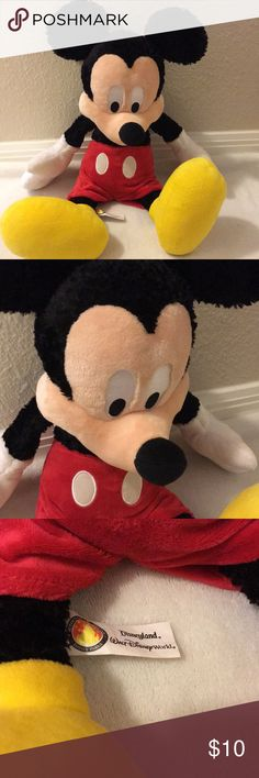 Mickey Mouse plush This is a gently used Mickey Mouse stuffed animal from Disney World. He has a small mark on his face which is barely noticeable as shown in the picture. Disney Other