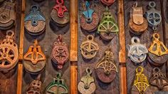 Antique Pulleys Photograph by Bill Wakeley