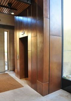 Bronze panel cladding at Wadham College Oxford Interior to new lift structure by TECU Consulting UK Cladding Materials, Cladding Systems, Cladding Panels, Wall Cladding Interior, Wall Cladding Designs, Rainscreen Cladding, Steel Cladding, Wall Exterior, Exterior Design