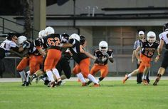 2015 Leesburg Yellow Jackets Football Archives, Umatilla at Leesburg spring game, Leesburg's Ed Smith (4) finds a hole in the Umatilla Bulldogs defense during the spring game between Leesburg High School and Umatilla High School at Leesburg High School on Thursday, May 21, 2015 in Leesburg, Fla. (Photo courtesy of Ashley Beyer, Freelance Photographer) Carver Heights Quarterback Club, Leesburg High School, Leesburg, Florida