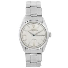 """The perfect vintage Rolex watch to pair with your """"summer whites,"""" this circa 1950s Vintage Rolex Oyster Perpetual Stainless Steel Men's Watch Ref. 6084 features a stainless steel case, a white guilloche dial with luminous hour markers, and a stainless steel Oyster bracelet. Rolex Gmt Master, Luxury Watch Brands, Luxury Watches For Men, Rolex Oyster Perpetual, Vintage Rolex, Rolex Submariner, Stainless Steel Bracelet, Stainless Steel Case, Rolex Daytona Stainless Steel"""