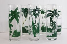 vintage Libbey tiki zombie glasses, tall tumblers w/ tropical scenes, palm trees