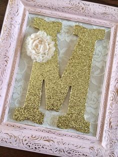 These Items Are Handmade-Made To Order Please allow 3-4 weeks production time Upcycled Ornate Picture Frame Measures 8x10 inch (inside) Frame Made of Resin Hand Painted in Antique Pink, Lavender Purple, Antique White (off-white) Classic White or Mint Distressed for a shabby chic look Gold and dark undertones 9 inch Wooden Letters in Plain or Scalloped edge font Gold or Silver Glitter Finish Shabby flower in Cream White Back of frame have been left unpainted. And comes ready to hang or di...