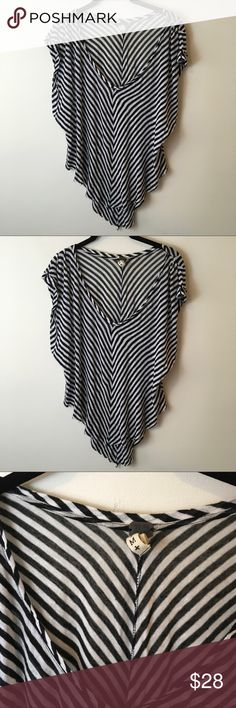 WE THE FREE Black White Striped Asymmetrical Shirt WE THE FREE Top black and white stripes with a sheer body and an asymmetrical back part with a split center. Light wear but nothing apparent. Free People Tops