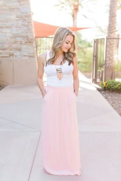 Peach pleaded maxi skirt with pockets.