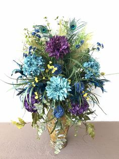 Purple and teal blue dahlia flower arrangement designed by Arcadia Floral and Home Decor.