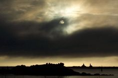 Lune macabre. Macabre Moon and clouds over Portsall, Finistère, France.  ©  Audrey CHARRIER