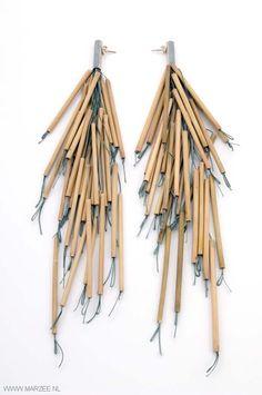 Lucy Sarneel - Jungle Rumours, 2011 - earrings, zinc, silver, bamboo, nylon thread - 230 x 40 x 35 mm