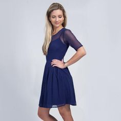 This ethereal frock from Shoshanna is crafted out of swiss-dot mesh and features our favorite fit-and-flare silhouette. Compliment the navy dress with a...
