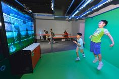 """Photo shows the exhibit """"Goalie Or Not?"""", in which visitors block footballs by using their bodies like a goalkeeper"""
