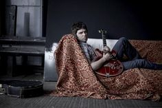 Noel Gallagher on the sofa