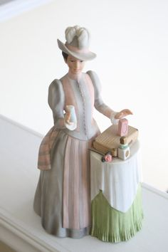Rare Avon Figurine porcelain Mrs Albee. A beautiful collectible Avon figurine of Mrs. Albee, the founder of Avon selling her wares long ago.