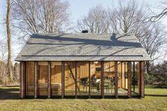 """The west side is clad with six shutters made of horizontal, western red cedar slats that can be opened or closed with a single movement. """"We wanted it to be able to feel cozy when needed,"""" Oostenbruggen says."""