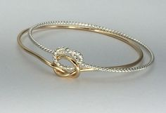 Twisted double knot bangle bracelet gold and silver