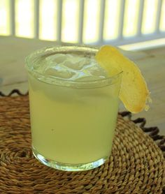 Here is a delicious and refreshing cocktail to enjoy in the warm months to  come. I made this margarita for a Memorial Day party that we had at  Katie's house and all of the adult guests enjoyed it. It's tart and sweet  and really perfect to have with chips and salsa during your cocktail hour.  A candied ginger garnish is a great counterpoint that you can nibble on  while drinking the cocktail. I love ginger!