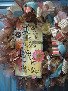 LIVE the LIFE you LOVE Spring wreath, with burlap / brown deco mesh, pink tulle, metal flowers, multi- ribbon- Summer Wreath. $55.99, via Etsy.