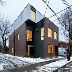 Naturehumaine completes a pair  of interlocking houses in Montreal. Very clever design. Making most of a relative small plot of land.