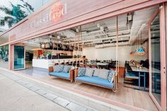 A Pair Of Swinging Sofas Greet You At This Restaurant