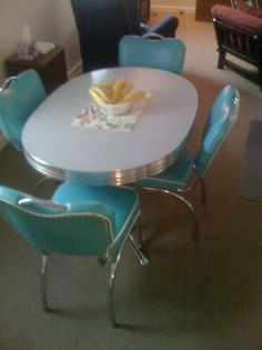 Old diner table with turquoise chairs.