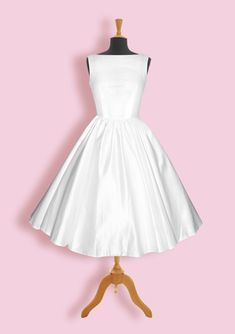 "You can do SO much with this simple ""Audrey"" dress. It's like a blank canvas waiting to be accessorized."