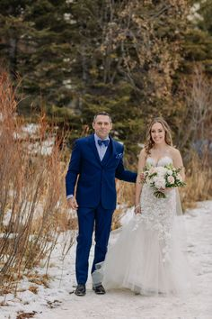 Epic Blue Ice on a freshly frozen Lake Louise makes a stunning backdrop for this winter wedding in the mountains! See more on the blog! Winter wedding inspiration in the Canadian Rocky Mountains. Adventurous winter elopement on newly frozen mountain lake with amazing blue ice. Rare blue ice at Lake Louise for an intimate November winter wedding. Where to get married in the mountains. Emotional outdoor wedding ceremony. Lake Louise Wedding Photographer ENV Photography. Elopement Inspiration. Winter Mountain Wedding, Outdoor Winter Wedding, Winter Wedding Inspiration, Elopement Inspiration, Fairmont Chateau Lake Louise, Elopements, Rocky Mountains, Engagements, Wedding Portraits