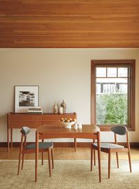 Thomas Moser Ellipse Table In Cherry With Knoll Soliloquy Shadow Fabric.