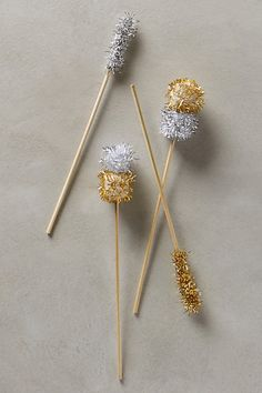 Pom-Pom Cocktail Stirrers @andierben these would be easy to make if you like them i can make them!