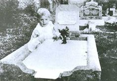 Mrs. Andrews was visiting the grave of her daughter in a cemetery in Queensland, Australia in 1946 or 1947. Her daughter Joyce had died about a year earlier, in 1945, at the age of 17. Mrs. Andrews saw nothing unusual when she took this photo of Joyce's gravemarker.    When the film was developed, Mrs. Andrews was astonished to see the image of a small child sitting happily at her daughter's grave. The ghost child seem to be aware of Mrs. Andrews since he or she is looking directly into the came