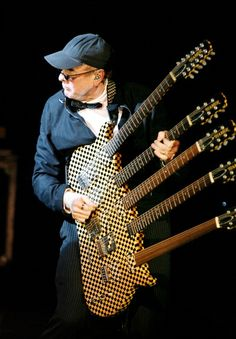 Rick Nielsen of Cheap Trick deserves a place on this board.