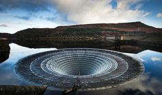 Interesting Photo of The Day - Down the Drain:  It's called a Bell-Mouth Spillway, and its an added safeguard against flooding at dam sites. Dams often have human controlled mechanisms for allowing water to pass through downstream, especially in cases where the water is used to generate electricity.