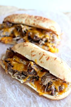Slow Cooker Beef and Cheddar Sandwiches--the easiest recipe to make ever. With only 4 ingredients total (beef, onion soup mix, cheddar and sandwich buns) you may be thinking that this recipe is just too easy to taste good. Well, you're wrong :) The flavor is amazing and your family will be asking for seconds.