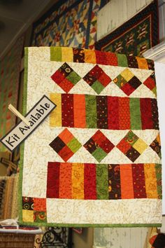 Love the colours and the pattern.... I be a jellyroll was used to make this quilt.....