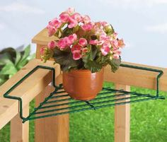Brilliantly simple for decks, patios, porches - simply place this strong coated-wire outdoor plant caddy wherever the railing forms an inside corner, and presto: instant space for a pot or planter. Think of mini rose bushes or hibiscus for this outdoor plant rack. Green. 19 1/4 long x 9 1/2 wide x 2 high, 2 3/4 of each arm rests on railing. $5.25