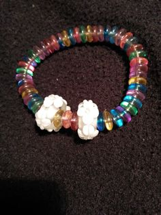 Check out this item in my Etsy shop https://www.etsy.com/listing/266205276/super-cute-rainbow-flowers-stretchy