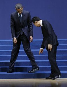 (This cracks me up!) U.S. President Barack Obama and South Korean President Lee Myung-bak, look for their marked positions on the floor as they arrive for a group photo session for the Nuclear Security Summit in Seoul, South Korea.