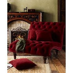 this crimson tufted chaise