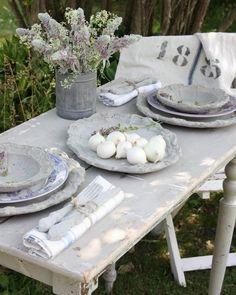 Dining al fresco, rustic tablescape, lilacs