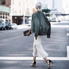 Add Elegance to a Bomber Jacket With a Simple Clutch