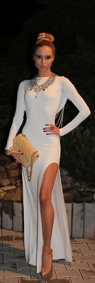 Glamorous one piece skin tight dress with curved slit.
