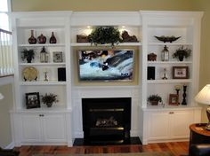 Inspiring Built In Bookshelves Around Fireplace Laminate Hardwood Flooring Wooden Side Table White Railing