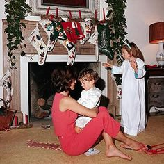 Jackie Kenndedy (holding John John) and Caroline at the Kennedy Palm Beach house celebrating Christmas