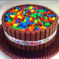 Yellow cake; chocolate icing; Kit Kats; and, plain & peanut M&Ms. Pinterest inspired!