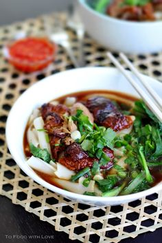 """Thai Duck Noodle Soup - Blogger says, """"The Thai-style version that I've featured in this post uses a stock made using duck bones, galangal, coriander root and some aromatics, and is served with wide rice noodles that I hand-cut to size. Though already tasty on its own, this noodle soup is really best eaten with some tangy, garlicky vinegar chilli sauce that also makes a great dipping sauce for the duck meat."""""""