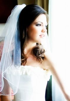 I like it when the veils are positioned a little higher on the head like this...feels more bridal to me