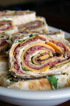 "From previous Pinner: ""Hye Rollers Sandwiches these are perfect for parties, picnics, barbecues and just about any other time. They're so much better than any store bought version. I Love Food, Good Food, Yummy Food, Roast Beef And Cheddar, Boite A Lunch, Wrap Sandwiches, Rolled Sandwiches, Pinwheel Sandwiches, Party Sandwiches"
