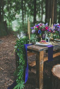 Brides.com: Unique Centerpiece Idea: Fresh Flower Runners. For a bohemian couple, florist Gavita Flora, based in Santa Cruz, California, created jewel-toned centerpieces paired with a deep-green leafy runner.