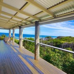 Wide sheltered decks are perfect for relaxing and taking in the views of the #surf and national park at #CastawaysBeach near #Noosa.