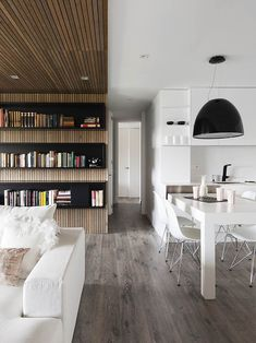 Dazzling Apartment Design For Amazing Book Lovers: Stunning Open Floor Living And Dining Room At Expresion Transversal With Wooden Floor App...