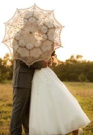 Lace umbrella makes a lovely photo in the evening sun.  We have several available for clients.  @ Khimaira Farm outdoor barn wedding venue Shenandoah Valley Blue Ridge Mountains Luray VA
