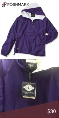 Purple Charles River Apparel Rain Jacket An all-around bestseller for 29 years! Lightweight and packs into its pouch for traveling. Wind and water-resistant River Tec Nylon with 100% cotton flannel lining throughout for softness. Conveniently packs into its front pouch pocket for storage. Extended zipper above neck offers extra protection against wind. Front pockets, elasticized cuffs and an open hem with shock cord drawstring. New with tags. True to size. Charles River Apparel Jackets…
